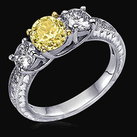 2.51 ct. yellow canary diamonds 3-stone engagement ring