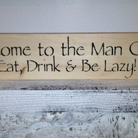 """MAN CAVE Sign  """"Welcome to the Man Cave, Eat Drink & Be Lazy""""  6x24, guy gift for garage, shed, bar, bedroom"""
