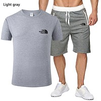 The North Face New fashion letter print top and pants two piece suit men Light gray