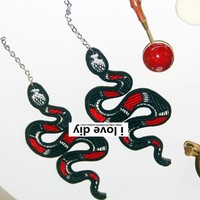 The original handmade embroidery snake-like long earrings club with a trendy personality and sexy snake-like earrings with small ears.