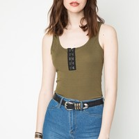 This soft lightweight cotton blended sleeveless tank top features a ribbed knit fabrication, low scoop neckline, and finished with black patch with eyes contrast.