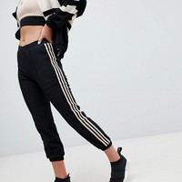 Adidas Originals Aa-42 Cuffed Joggers In Black And Beige at asos.com