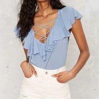 Pull Some Strings Ruffle Blouse