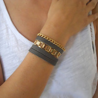 Black leather wrap bracelet with 2 different gold plated chains