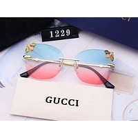 GUCCI fashionable and recreational male lady gradual change lens rimless bee design dazzles coloured sunglasses