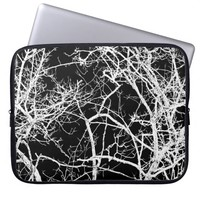 Tree branches on black background laptop sleeves