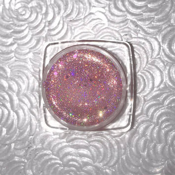 Shade name ( Love Bite ). A gorgeous rosey-mauve holographic loose glitter pigment. 4 grams of product in a jar with sifter and seal.