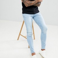 River Island skinny stretch jeans in light wash blue at asos.com