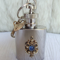 Mini flask key chain, key chain flask is adorned with filigree setting with tiny pearl and blue rhinestone