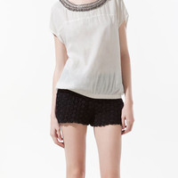 NECKLACE TOP WITH ELASTICATED HEM