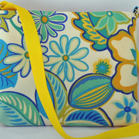 a cute medium size crossbody bag. Turquoise yellow floral. Handmade by RiverPurseWorks
