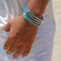 Gold Tubes and Turquoise Leather Bracelet