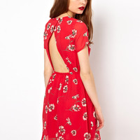 A Wear Tea Dress With Cut Out Back
