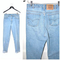 90s grunge LEVIS mom jeans / vintage early 1990s high waisted LIGHT WASH faded denim boyfriend jeans size 29 30