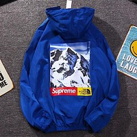 Supreme & The North Face New fashion letter snow mountain print hooded long sleeves windbreaker Blue