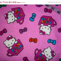 Hello Kitty Flannel fabric with teacups and bows  cotton quilting sewing  material 1yd by the yard