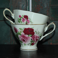 Pair of Baum Brothers Formalities Victorian Rose floral teacups with gold trim, footed teacups