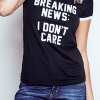DON'T CARE GRAPHIC RINGER TEE