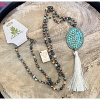 1N334TT Large turquoise oval with cream tassel