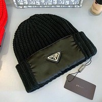 Prada letter inverted triangle logo knitted hat warm hat men and women woolen hat