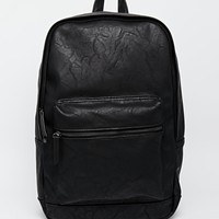 ASOS Faux Leather Backpack In Black at asos.com