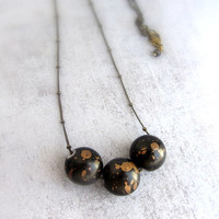 Black and gold beaded necklace with star dust beads, galaxy cosmic jewelry, long bead necklace.