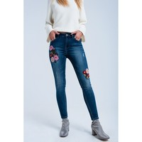Skinny jeans with embroidered flowers