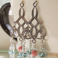 Sterling silver filigree, scroll chandelier earrings with faceted aquamarine and coral color glass beads. Handmade fashion jewelry.
