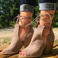 suede booties that lace and wraps around the ankle