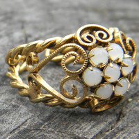 Vintage Gold and Moonstone Ring with Scrolls and Braids
