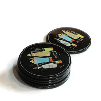 Vintage cork and plastic coasters. Black coasters with typical 1960's design. Six coasters.