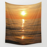 Sun setting over calm waters Wall Tapestry by Nicklas Gustafsson