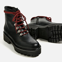 LEATHER ANKLE BOOTS WITH TRACK SOLE