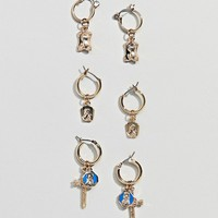 ASOS DESIGN pack of 3 hoop earrings with vintage style cross and icon charm in gold at asos.com