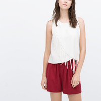 Fringed cross-over top