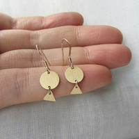 Circle and triangle geometric round gold dangle earrings.