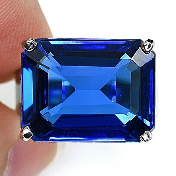 A Vintage East West Natural 17.5CT Emerald Cut Blue Topaz Ring