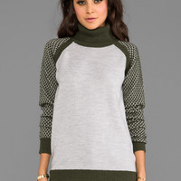 primary Tread Turtleneck Sweater in Amber/Grey from REVOLVEclothing.com