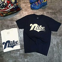 NIKE Fashion new bust letter print women and men loose leisure short sleeve top t-shirt Navy blue