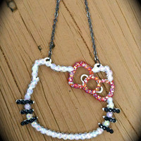 Iridescent White HELLO KITTY necklace by Sugar and Speisz