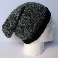 Hand knitted men's slouchy beanie hat. Adult or teenager. Black and grey marled tweed with black rib.