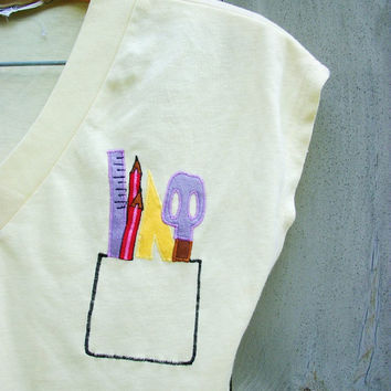 Vintage top - Pale yellow sleeveless T-shirt with unusual applique