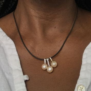 3 pearl necklace on a leather cord  necklace