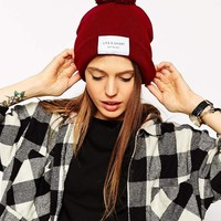 ASOS   ASOS Life Is Short Label Beanie With Pom at ASOS
