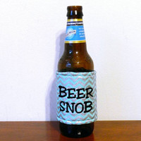"""Icy Blue and Shiny Silver Chevron Print """"Beer Snob"""" Insulated Embroidered Beer Bottle or Can Cozie with Velcro Closure"""