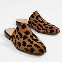 ASOS DESIGN Moonshine leather mules in leopard print at asos.com