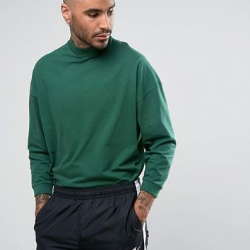 ASOS Oversized T-Shirt With High Neck And Cropped Arm In Green at asos.com