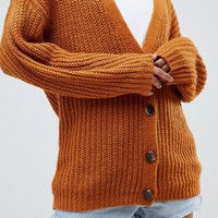 ASOS DESIGN oversize cardigan in chunky rib with buttons at asos.com