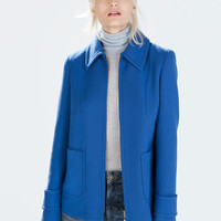 Short seamed jacket with zip