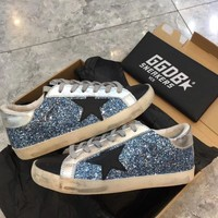 GOLDEN GOOSE SUPER STAR DISTRESSED DENIM SNEAKERS